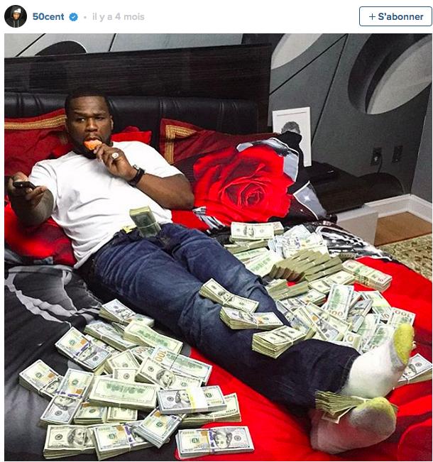 En faillite, 50 Cent exhibe des liasses de billets